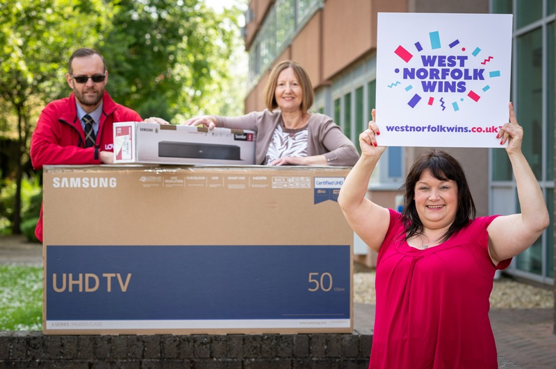 Lottery winner collects TV and sound bar